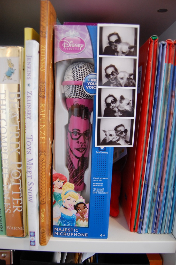 "Among my prized possessions is this ""Mike Mic""--a Disney Princess karaoke microphone on which Samantha Berger drew my portrait. That's a photo strip of Samantha and her pup, Polly Pocket. Sam and I sing together a lot."
