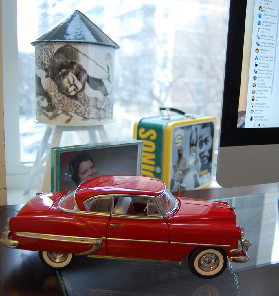 Here is a water tower painted by Marcos Chin, a picture of my best friend, Jill, and this model Chevy that I bought to help me with some reference on a new secret project I'm working on ;)
